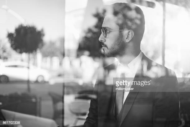 young business man waiting at the airport in the airplane