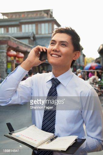Young Business Man Working in Houhai, Beijing : Stock Photo