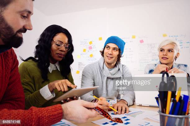 Young business people in office, developing start-up business ideas