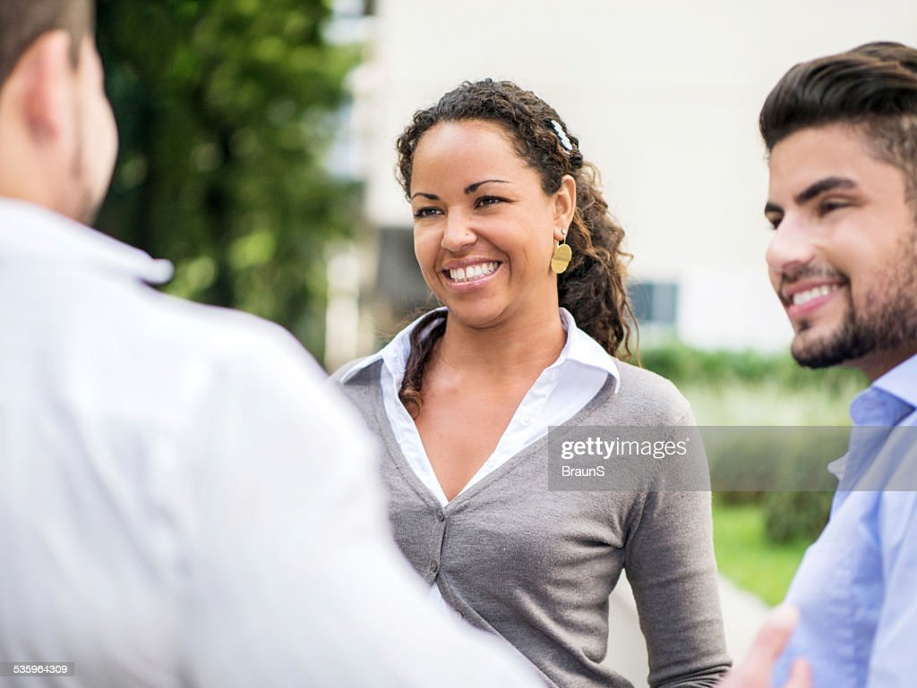 Young business people talking outdoors. : Stock Photo
