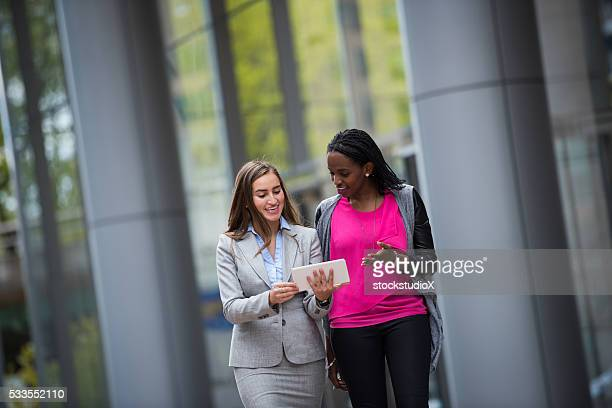 Young business professionals meeting outside