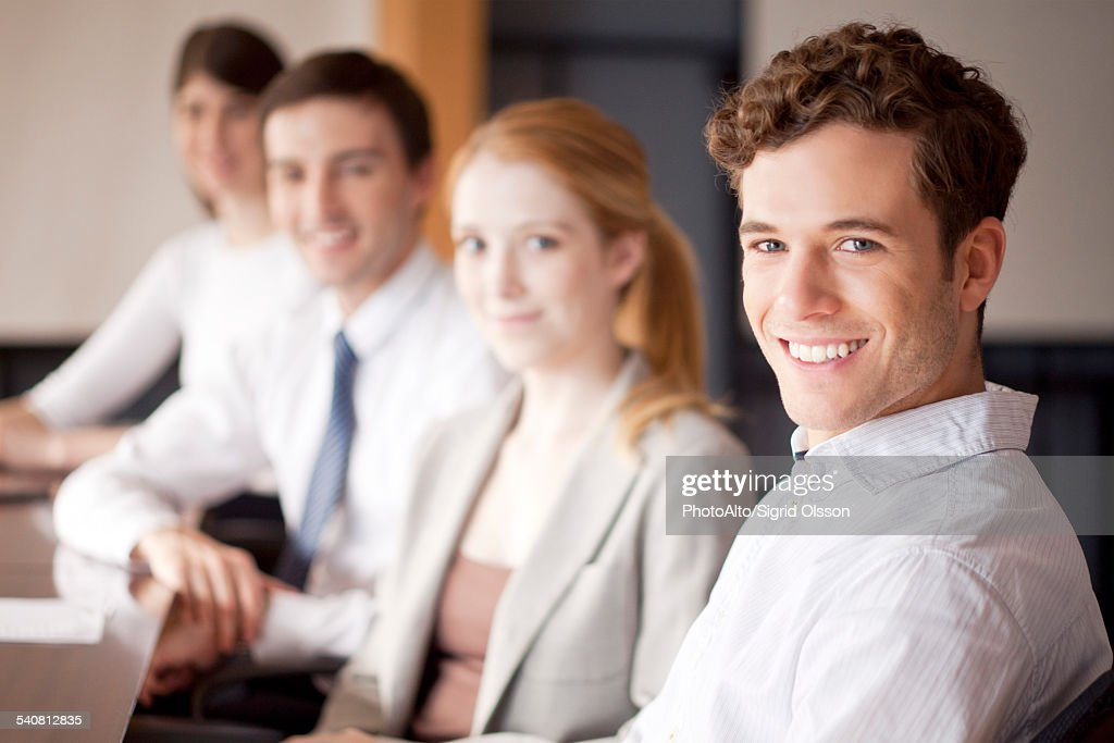 Young business professionals seated in conference room