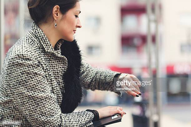 Young business woman at bus station