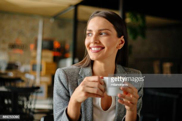 Young business woman drinking coffee