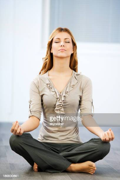 Young business woman exercising yoga