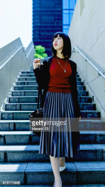 Young business woman just down the stairs