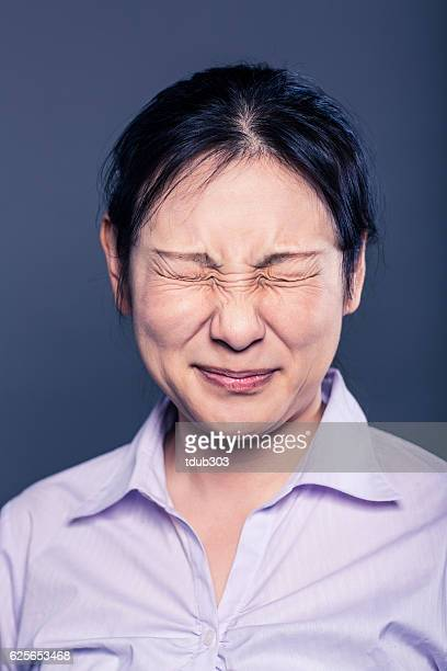 Young business woman looking uncomfortable and frustrated