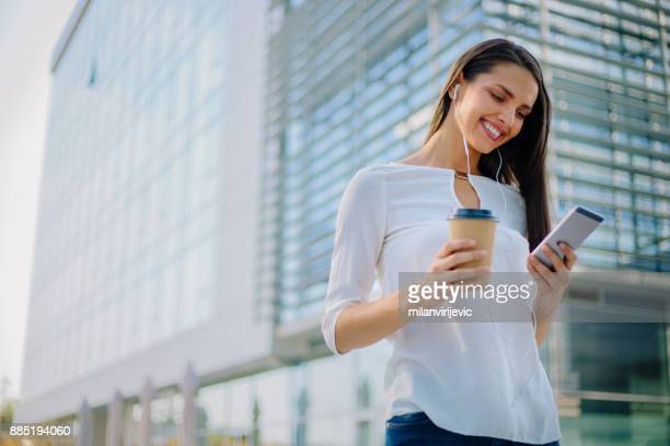 Young business woman on coffee break outdoors