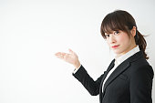 Young business woman pointing something with smile