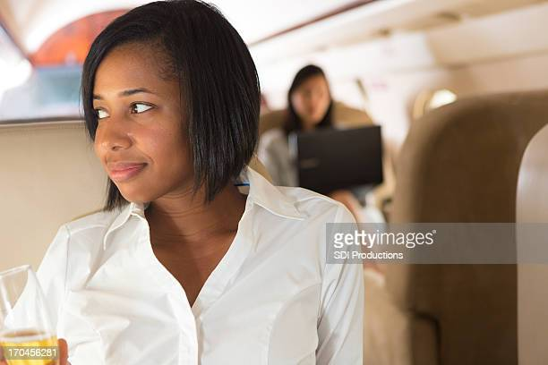 Young business woman traveling in luxurious private jet