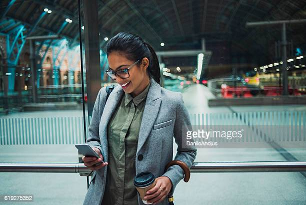 young business woman using her smartphone