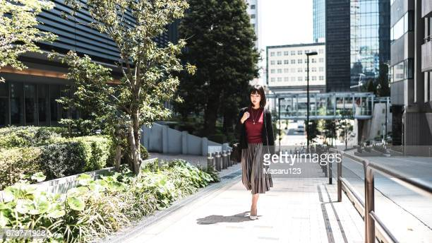 Young business woman walking through downtown in Tokyo