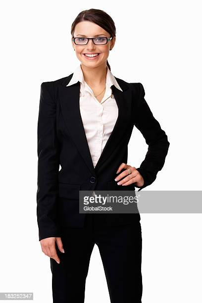 Young business woman wearing spectacles standing against white