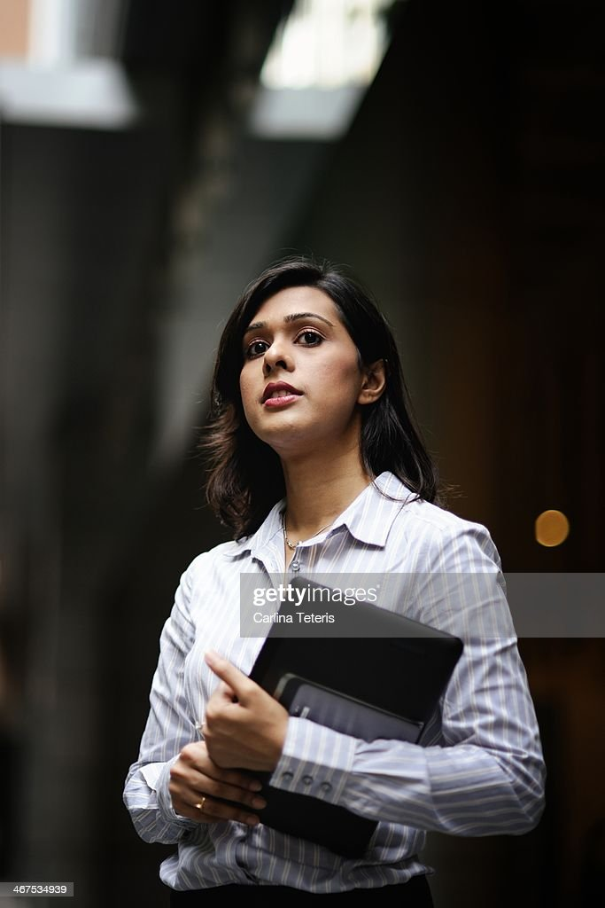 Young business woman with a tablet outdoors : Stock Photo