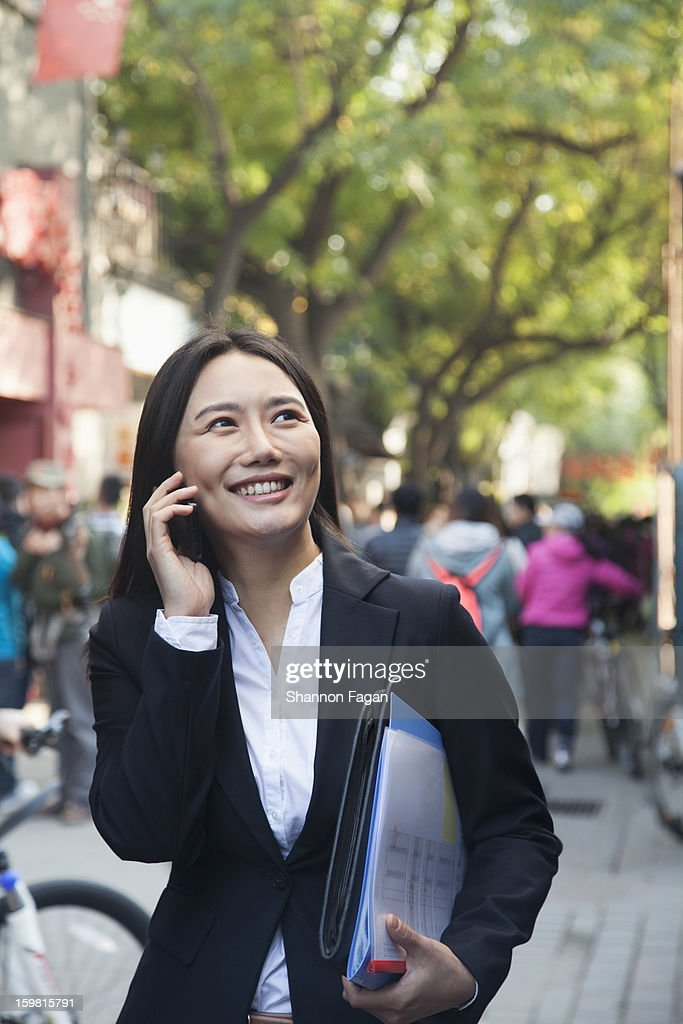 Young Business Woman with Cell phone : Stock Photo