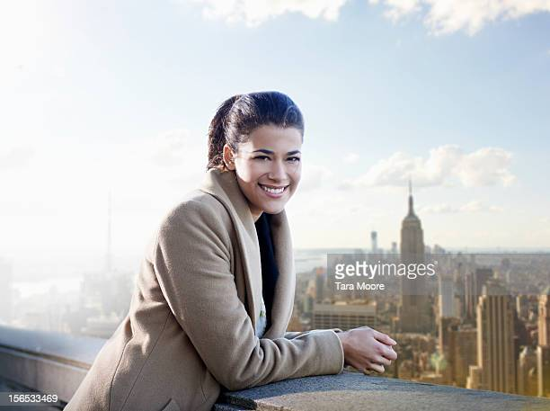 young business woman with city in background