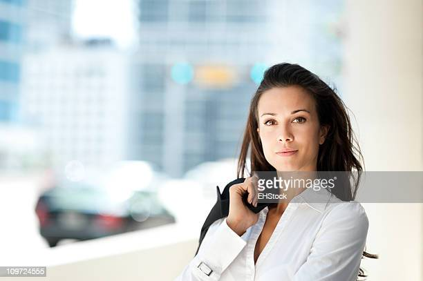 Young Business Woman with Coat over Shoulder