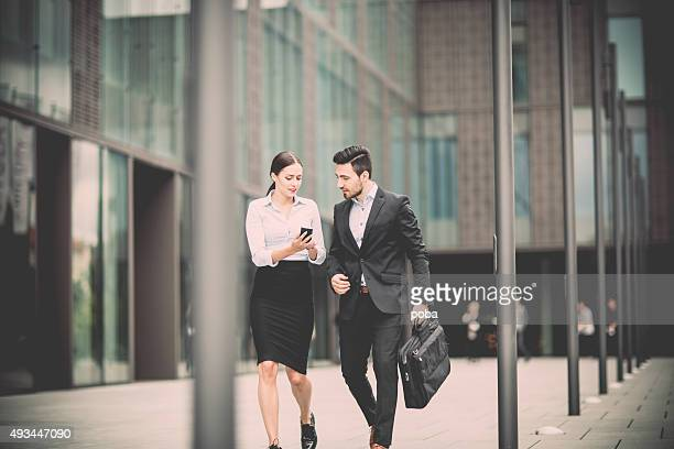 young business woman with  colleague walking  in the business district
