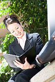 Young business woman with diary, outdoors