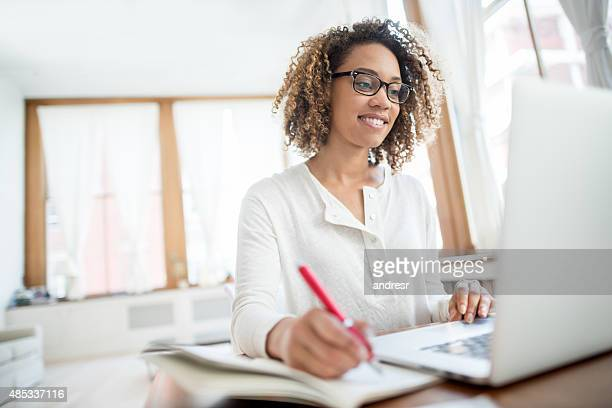 Young business woman working at home