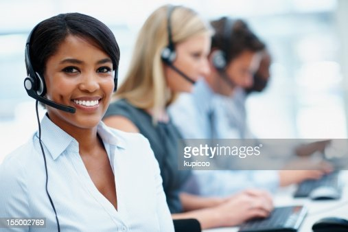 Young business woman working in a call center with colleagues