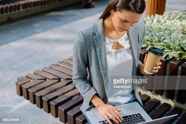Young business woman working outdoors