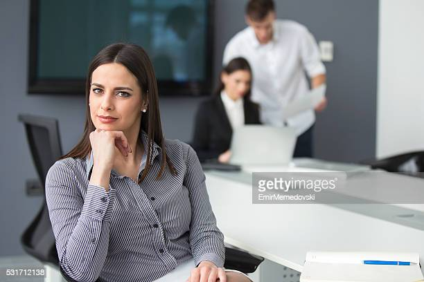 Young business women sitting at the office.
