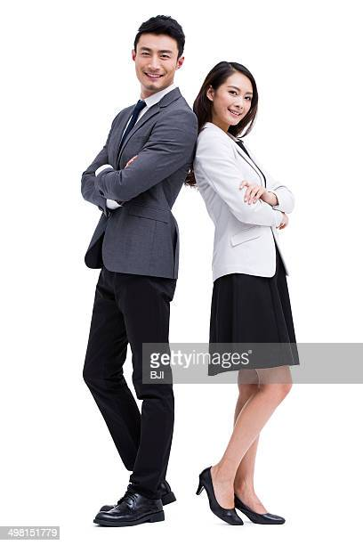 Young businessman and businesswoman back to back