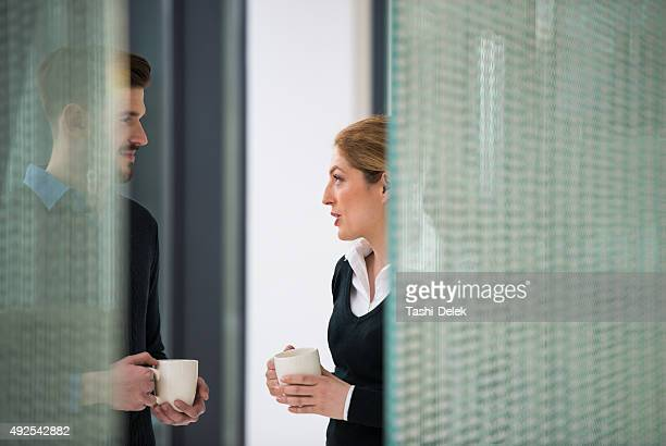 Young Businessman and Businesswoman Discussing