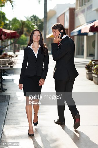 Young Businessman and Businesswoman Walking