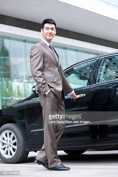 Young businessman and car