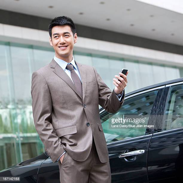 Young businessman and cellphone