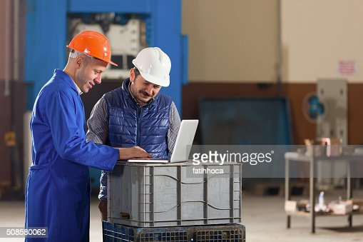 Young Businessman and Foreman : Bildbanksbilder