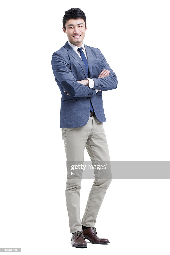 Young businessman arms crossed : Stock Photo