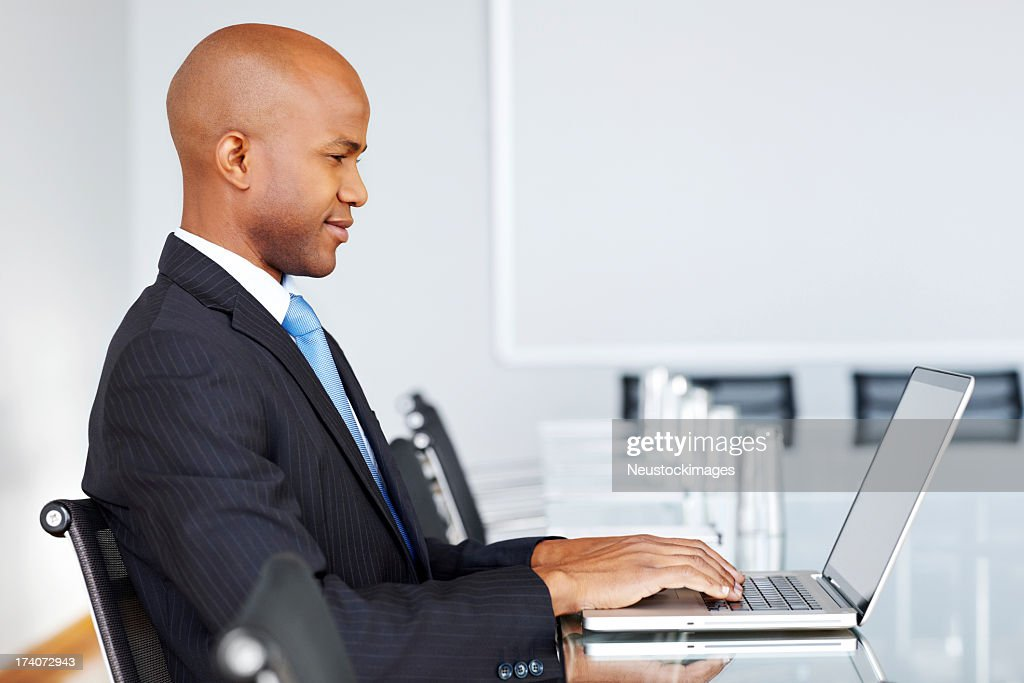 Young Businessman at a Laptop : Stock Photo