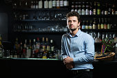 Young businessman at bar counter
