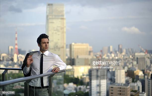 Young businessman at Tokyo's background