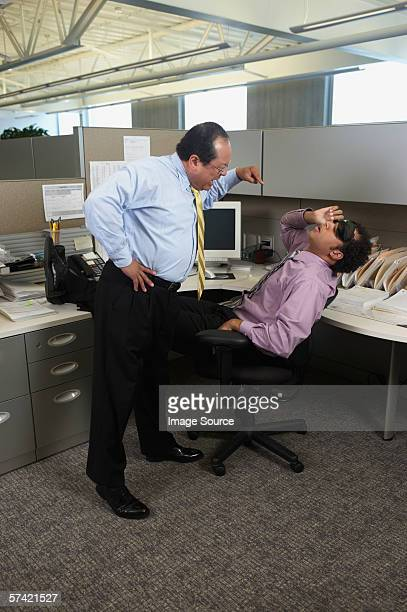 Young businessman caught sleeping by coo