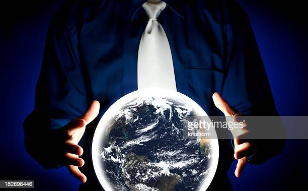 Young Businessman Consulting Crystal Ball for Earth Future