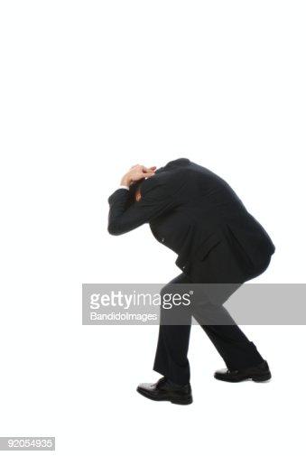 Jeune homme d'affaires devant la tête : Photo