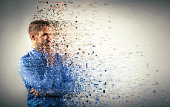 Young businessman dispersing into pixels. Dissolution and breakdown illustration.