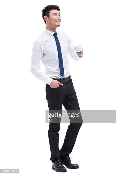 Young businessman drinking tea