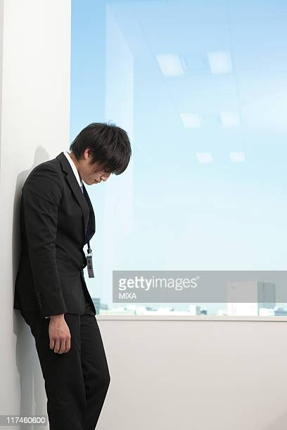 Young businessman drooping down at office