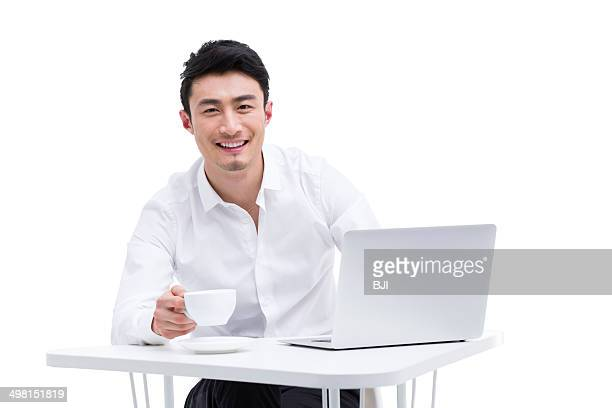 Young businessman enjoying coffee
