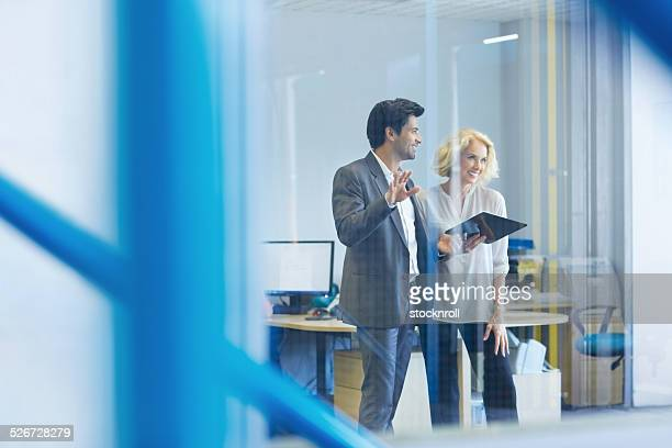 Young businessman explaining business plan to a senior woman