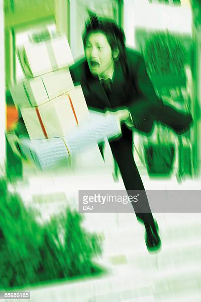 Young Businessman Falling With Gifts
