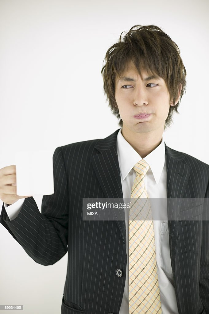 Young businessman gargling : Stock Photo