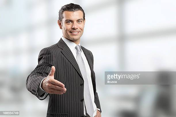 Young businessman giving handshake