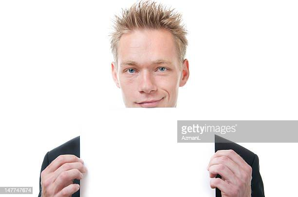 Young businessman holding a card