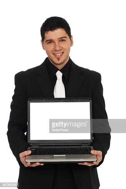 Junger Geschäftsmann hält einen laptop in der hand und Lächeln